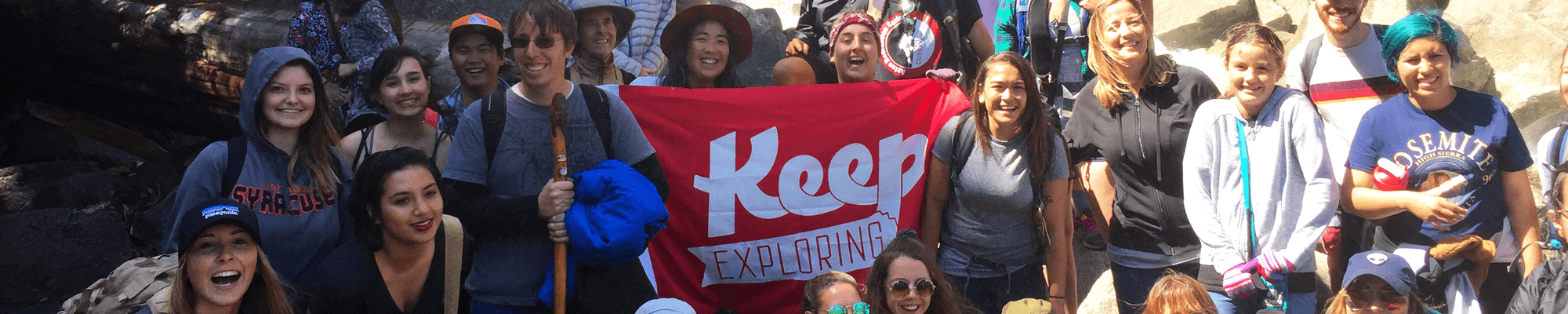 Geography field trip to Yosemite, group photo, banner being held that says Keep Exploring